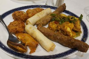 Starter plate of Chicken Pakora, Duck Rolls, Shish Kebab, Monk Fish, and Onion Bhajis