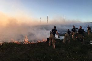 Firefighters at the height of the Rivington blaze last year