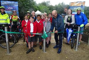 The first of South Ribbles Green Links pathways was officially opened by CounMick Titherington. Pictured: Coun Titherington, Walton-le-Dale Primary School Year 5 pupils, Outram House residents, Jennifer Mullin (South Ribble assistant director) and South Ribbles Sports Development & Projects team members
