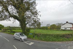 The greenfield site at the junction of Chainhouse Lane and Church Lane which is the subject of a planning appeal.