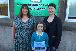 Jeannie Wilkinson with her letter, pictured with her mother Emma (right) and St Joseph's headteacher Mrs Moya Smith