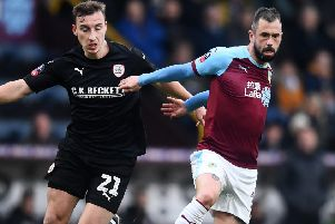 BURNLEY, ENGLAND - JANUARY 05: Steven Defour of Burnley is challenged by Mike-Steven Bahre of Barnsley during the FA Cup Third Round match between Burnley and Barnsley at Turf Moor on January 5, 2019 in Burnley, United Kingdom.  (Photo by Nathan Stirk/Getty Images)