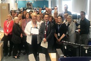 ELHT Employee of the Month for September Tracey Smith (front centre) receives her award from Chief Executive Kevin McGee