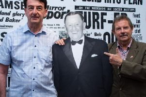 Mike Smith and Dave Thomas pose with a cardboard cutout of Bob Lord