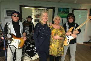 Julie (right) and Vicky with Badger Sett at their band night for Rosemere Cancer Foundation