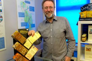 Bruce Crowther pictured with some of The Fig Tree's Fair Trade chocolate