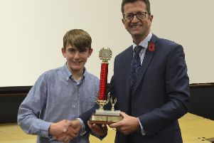 Headteacher Mr Michael Wright presenting his award to student Harry Mason.