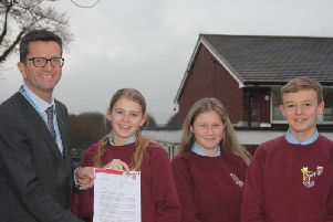 Mr Wright with the letter of congratulations from Lancashires Interim Executive Director for Education, John Readman.