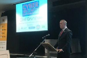 Lancashire's Police and Crime Commissioner Clive Grunshaw speaking at the cyber crime event.