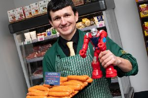Danny Heys with his Peter Crouch inspired sausages