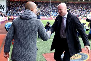 Burnley manager Sean Dyche (right) has led Burnley FC for their latest period of growth, which has seen the side ranked as the seventh-most valuable in the division.