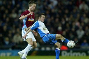 Gary Cahill holds off Paul Dickov while on loan with Burnley