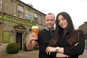 New landlord of The Four Alls, Michael Bann, toasts his return with partner Marina Palazon