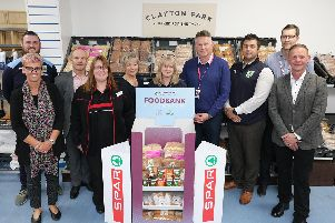 Representatives from Burnley Community Kitchen, Clayton Park Bakery, James Hall & Co. and staff from SPAR Padiham Road, where a new foodbank initiative was first trialled. (s)