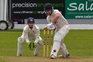 Clitheroe's Kyle O'Connor in action behind the stumps