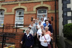 Capt. Elizabeth Smith with volunteers of The Salvation Army, Clitheroe, outside their new base