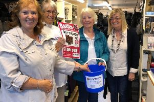 From left, festival visitor Janice Ellis, draws the raffle watched by Rosemere volunteers Doreen Hammond and Rosalie Cook with Christine Gainsley.