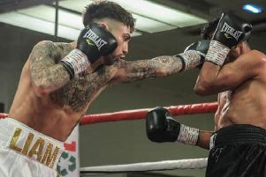 Liam Dring, who is celebrating victory in the second bout of his professional career.