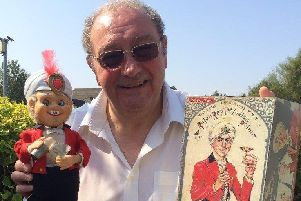 Mike Stockwell with Rajah Rey the Indian Prince, a toy based on Richard Burton in 1955 film The Rains of Ranchipur, thought to be worth �20,000-�30,000.
