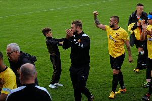 Grant Black leads the applause for Belper's supporters after Saturday's win over Stocksbridge Park Steels. Pic by Tim Harrison.