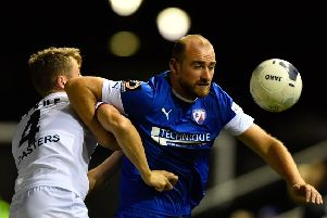 AFC Fylde's Neill Byrne competes for the ball with Chesterfield's  Tom Denton: Picture Steve Flynn/AHPIX LTD, Football, National League, AFC Fylde v Chesterfield, Mill Farm, Wesham, UK, 08/10/19, K.O 7.45pm'Howard Roe>07973739229