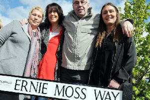 The Moss family has always believed Ernie's dementia was a result of him heading old heavy leather footballs during his career. Ernie is pictured with his wife Jenny and daughters Nikki and Sarah at the unveiling of Ernie Moss Way in 2017.