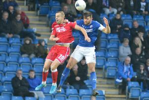 Chesterfield captain Will Evans challenges for the ball in the air against Chorley.