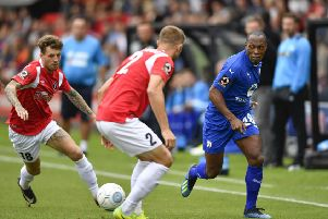 """Chesterfield�""""s Kyel Reid runs at Salford's Scott Wisemans: Picture by Steve Flynn/AHPIX.com, Football: Vanarama National League match Salford City -V- Chesterfield at Peninsula Stadium, Salford, Greater Manchester, England copyright picture Howard Roe 07973 739229"""