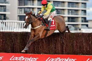 Sizing Tennessee striding to victory in the Ladbrokes Trophy at Newbury.
