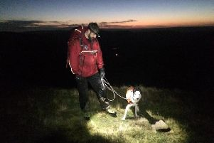 Mountain rescue teams were joined by Search and Rescue Dog Association's search dog Flo in their operation to find two missing walkers who had been hiking around Edale.