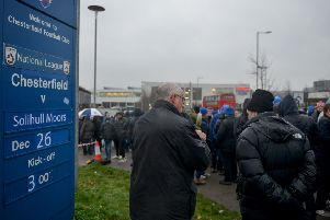 Chesterfield FC fans demonstrate outside the ground before the match