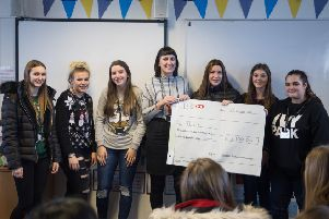 Students from Chesterfield College's Childhood Studies department present �2,180 to JOEL which supports families after the loss of a baby.