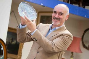 Andy Green with Lalique glass. Photo courtesy of Hansons Auctioneers.
