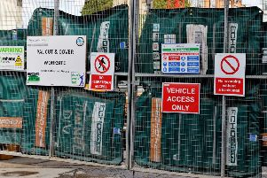 Stock photo of construction safety information signs at the site entrance of the new offices, station entrance and shops at Victoria Station, in central London.