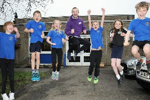 Ryan Smith, a teacher at Stonelow Junior School, has won a BBC video competition urging kids to be active, which looks to be working with some of the children from the Dronfield school. Picture by Anne Shelley.
