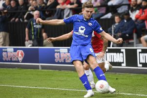 """Chesterfield�""""s Laurence Maguire crosses the ball: Picture by Steve Flynn/AHPIX.com, Football: Vanarama National League match Salford City -V- Chesterfield at Peninsula Stadium, Salford, Greater Manchester, England copyright picture Howard Roe 07973 739229"""