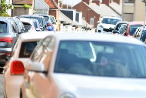 Police say a mum and her young daughter were nearly hit by a car when they had to walk on the road because of an inconsiderately parked vehicle.
