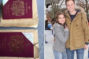 Charlie Wood, pictured with partner Gemma, received a stranger's passport in the post as well as his own.