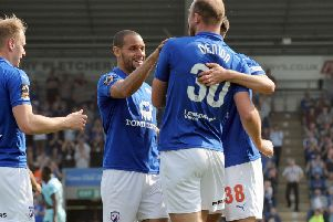 Tom Denton celebrates with team mates after equalising in the first half.