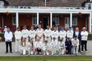 Players line up in front of the Queen's Park pavilion for the anniversary match.