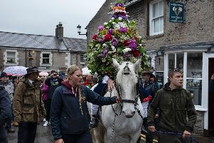 The Garland King is processed through the village.