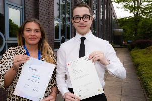 Melissa Selby and Callum Loveridge with their certificates: