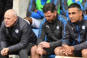 Nicky Eaden, centre, is the new Kettering manager