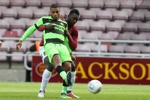 NORTHAMPTON, ENGLAND - OCTOBER 13:   Reuben Reid of Forest Green Rovers controls the ball under pressure from Aaron Pierre of Northampton Town during the Sky Bet League Two match between Northampton Town and Forest Green Rovers at the PTS Academy Stadium on October 13, 2018 in Northampton, United Kingdom. (Photo by Pete Norton/Getty Images)