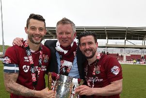NORTHAMPTON, ENGLAND - APRIL 30:  Marc Richards( left),David Buchanan and manager Chris Wilder of Northampton Town celebrate with the Sky Bet League Two champions trophy after the Sky Bet League Two match between Northampton Town and Luton Town at Sixfields Stadium on April 30, 2016 in Northampton, England.  (Photo by Pete Norton/Getty Images)
