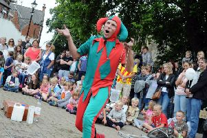 The court jester raises a laugh at Medival day in Chesterfield on Tuesday.
