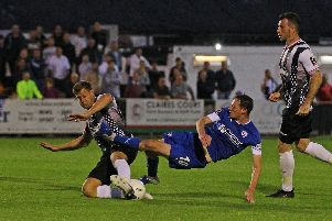 Chesterfield's Liam Mandeville sees his effort blocked by United's Alan Massey. Picture: Gareth Williams/AHPIX LTD.