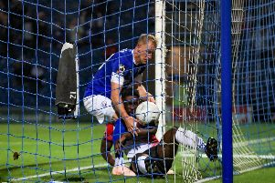 Scott Boden picks the ball out of the net after pulling one back for Chesterfield