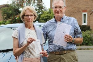 Philip and Janette Court with the parking ticket claiming they'd left the site and their till receipt proving they were inside shopping.