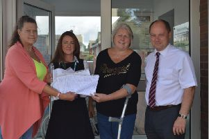 Handing over a petition of 600 names protesting at plans to close Pilsley surgery: Shelia Baldwin, Dr Ruth Cater (Practice Manager for Staffa Health), Wendy Hardwick and Clouncillor Kevin Gillott.